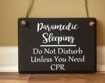 Paramedic Sleeping/ Do not disturb unless you need CPR/Please do not knock/Please do not ring bell/wood sign hand painted funny sign