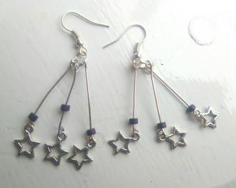 Purple star burst earrings