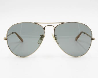 Authentic 1960s aviator sunglasses OPTISOL, crystal lenses and Golden metal frame, Deadstock