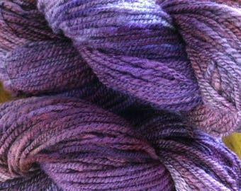 368 yards artisan yarn. Hand carded spun and dyed 2 ply worsted yarn. Plum Violet Purple