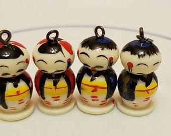 Small acrylic kokeshi doll charms