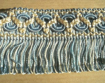 Pretty lace viscose, ecru, and blue color with embroidered designs, width 44 mm