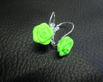 Stud Earrings with a small neon pink