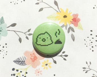 Tamagotchi and Poop- one inch pinback button