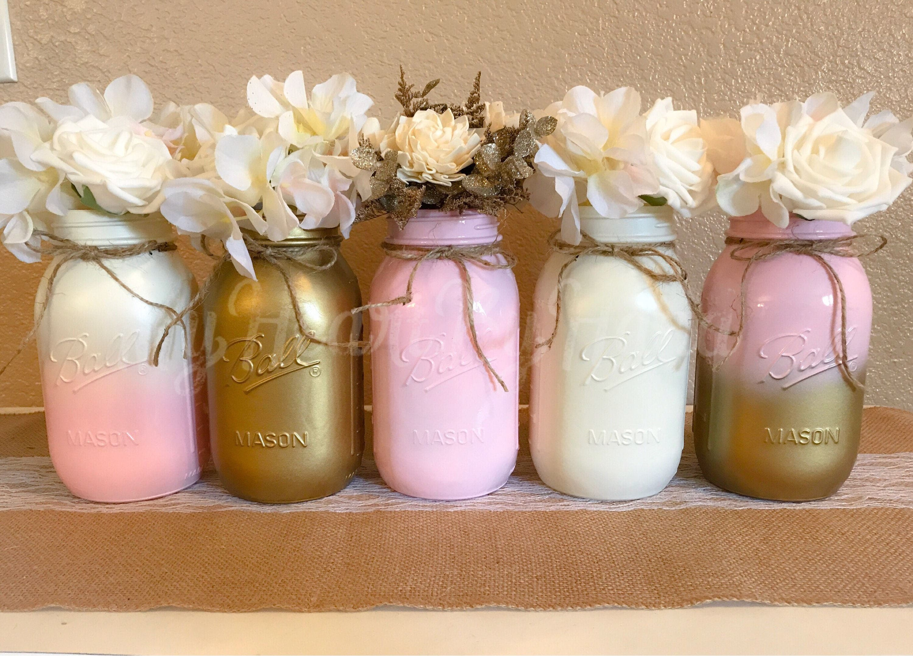 Mason jar centerpieces pink and gold baby