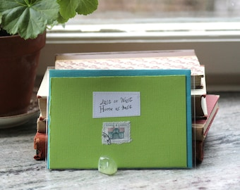 East or west Home is best Apple green card with handwritten quote and house postal stamp