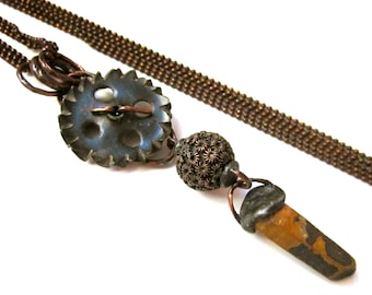 Where Does a Body End? - primitive industrial assemblage rusty ochre crystal point, vintage gear, Nepal bead, long brass metalwork necklace