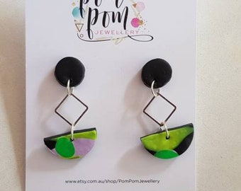 Handmade polymer clay and silver dangles.