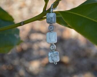 white and grey stone pendant