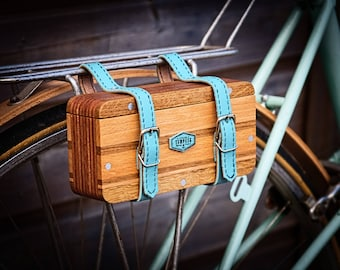 wooden saddle bag bicycle . leather strap and chrome steel buckles . linseed oil finish.