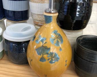 Crystalline olive oil bottle