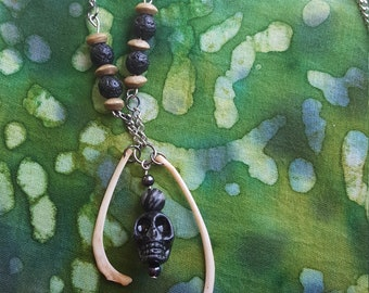 Raccoon ribs and skull charm chain necklace with beads