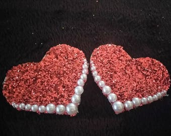 Red glitter hearts and pearls