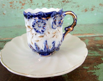 Vintage Demitasse teacup saucer Cobalt blue raised flowers