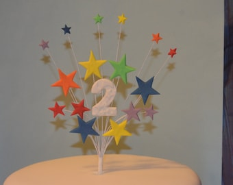 Rainbow stars on wires cake topper with ribbon