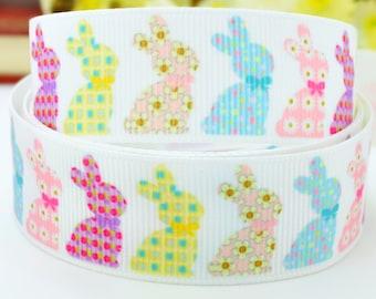Pretty colourful Rabbit print 22mm single sided 100% polyester, grosgrain ribbon per metre.