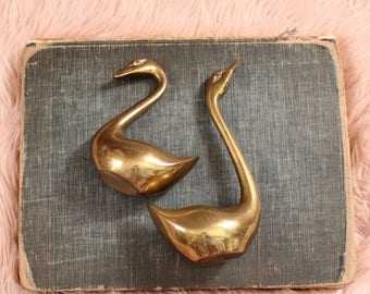 vintage brass swan set . solid brass bird pair . vintage brass gold home decor . large brass paperweights or jewelry bracelet holders