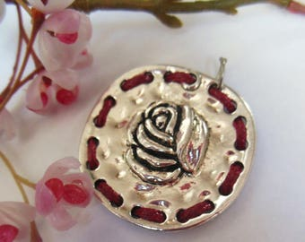 pretty Medallion in silver and Red cord