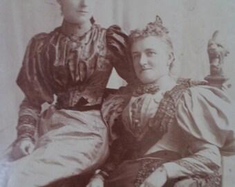 scary photograph, dragon chair, horned women, horns on head, victorian photograph, antique photograph, halloween card