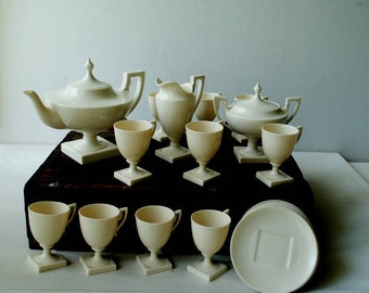 Art nouveau vintage 30s,  off white  porcelain tea set: tea pot, sugar bowl, creamer and ten tea cups with a sausers. Made by Lenox in USA.