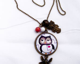 pink little OWL with a heart pendant