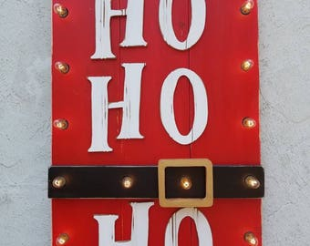 Ho Ho Ho lighted sign.