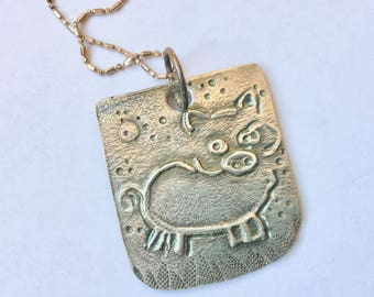 new piggy pendant in sterling