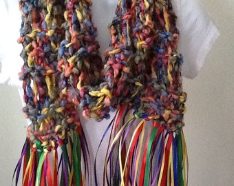 Colorful knitted scarf with ribbon fringe