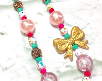 Fashion girl. Kids jewelry. Teal. Pink. Gold. Bow. Princess. Gift for girls. Bubblegum bead necklace. Birthday party. One of a kind.