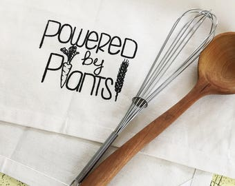 Powered by plants vegan organic cotton kitchen dish towel. Silk screened cotton tea towel.