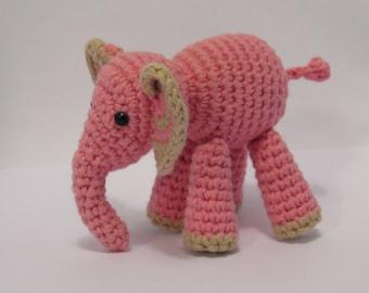 Amigurumi pink elephant, cute crochet animal.