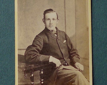 Carte-de-visite, antique.   Featuring a serious seated young man.  Israel Todd, Otley, (W. Yorks).  c 1890's.