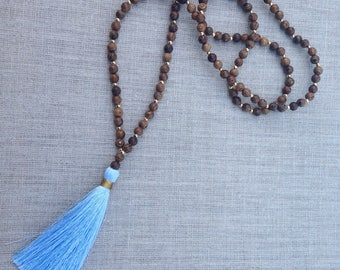Wood bead necklace with powder blue tassel
