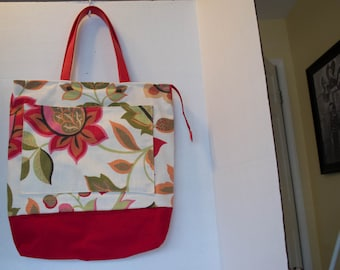 Lovely pink, red and white floral zippered tote with red leather handles