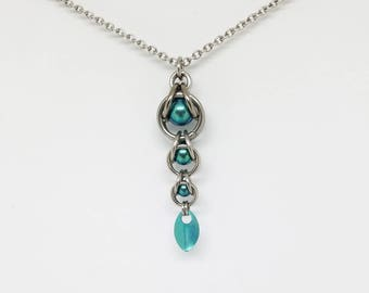 Teal Green Captured Titanium Ball Chainmaille Stainless Steel Pendant with Tiny Titanium Teal Scale