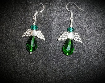 Emerald green angel earrings with silver wings. French style silver ear wires.