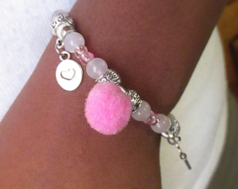 Beautiful bracelet with memoir shape rose quartz.