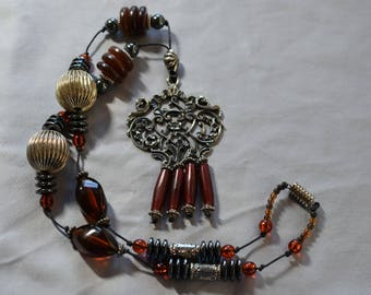 Brown and silver necklace with pendant with dangles