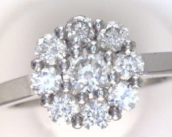 Round Cut Diamond Cluster Set Ring. In 100% Palladium.