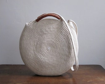 Round Basket Bag with Leather Top Handles and Shoulder Strap