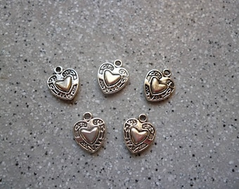 5 lovely heart charms in silver