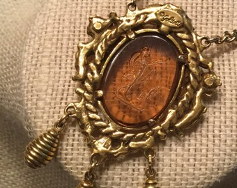 Romantic Signed Goldette Amber Brown Reverse Intaglio Pendant Necklace 1960's 1970's Ornate Cherub Gold Tone Framed Dangles Oval Shape Angel