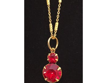 Gold plated 925 sterling silver necklace with Swarovski ruby crystal 2 drop pendant.