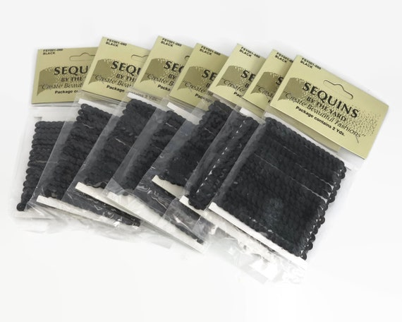 6mm black sequins on ribbon, can be cut to length, sold in packets of 2 yards each, vintage dead stock