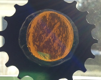Bicycle Art: Stained glass, repurposed bike sprocket in warm gold tones