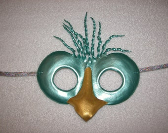 Hand Sculpted Light Green Leather Bird Mask finished with metallic paints.