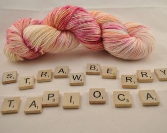 "Hand-dyed yarn, ""Strawberry Tapioca"" variegated, soft and squishy yarn. Great for socks or shawls. 60/20/20 Superwash wool/Nylon/Alpaca"