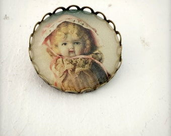 Photo Brooch of An Antique Porcelain Bisque Kewpie Doll Adventures of Claudia Pin