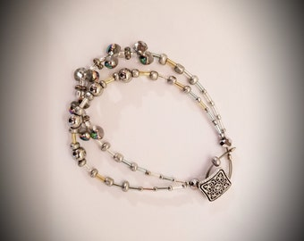 Winter ice. Silvery, clear and bubble like glass beaded bracelet