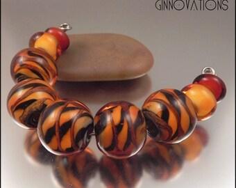 Ginnovations lampwork, Animal bead set (9 beads)